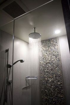 Zen shower using Bali Ocean pebble tile as accent piece. https://www.pebbletileshop.com/products/Bali-Ocean-Pebble-Tile.html#.VgwKXBFViko