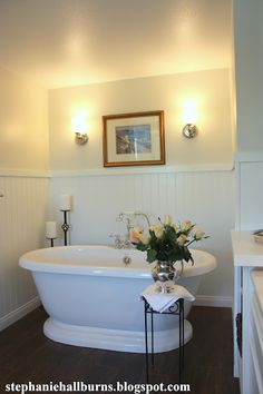 BALANCED STYLE: love the dark floors, white bead board and that tub!