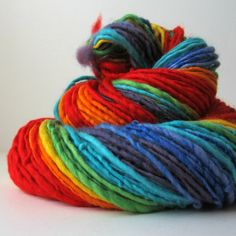 Rainbow Handspun Yarn, Merino Wool, Single Ply, 120-180 yards,  DL004. $30.00, via Etsy.
