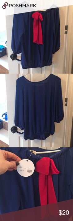 3/4 sleeve tulip back shirt with elastic bottom Tulip back with elastic on ends of sleeves & bottom. Bow in the back with a slight hi/low back. Super cute on. Bought this @ a boutique & never wore it. J & M Tops Blouses