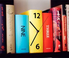 Give your book collection a unique touch with this book clock. Designed to look like three colorful books standing next to each other, this clever clock will...