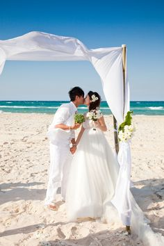 White beach pagoda creates a beautiful ceremony backdrop.