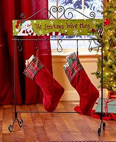 "The Standing Holiday Stocking Hanger offers a charming alternative to hanging stockings on the mantel of your fireplace. It features a scrolled metal frame with an attached MDF plaque. Comes with 6 ""S"" hooks for hanging stockings. x x 3 Christmas Stocking Holder Stand, Christmas Stocking Hangers, Stocking Holders, Christmas Stockings, Stocking Ideas, Stocking Stuffers, Christmas Snowman, Christmas Home, Christmas Holidays"
