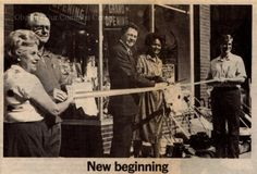 """ID#:0066 Date:1983. Photograph of the 1983 sale of Watson's Hardware by Glenn """"Jim"""" Molyneaux, Jr. and his wife Barbara to Warren Carter of Hudson, Ohio. Participant:Barbara Molyneaux. Additional Sources: O.H.I.O. Resource Center: Fred Maddock files., Historic Preservation Commission, Survey 1998, City Directories;Internet correspondence from Jim Molyneaux, 01/16/01. Interview with Jim and Barbara Molyneaux, 6/00. Interview with Glenn Molyneaux, 6/00; Interview with Pat Stetson, 01/01"""