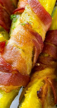 These bacon wrapped pickles are pickle spears wrapped in smoky bacon, then baked to crispy perfection. Serve with ranch for the ultimate low carb snack! Delicious Appetizers, Yummy Appetizers, Appetizers For Party, Bacon Wrapped Pickles, Party Food And Drinks, Hors D'oeuvres, Vegetable Side Dishes, Finger Foods, Finger Food