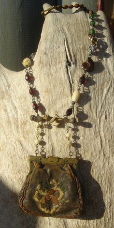 Antique Victorian French Coin Doll Purse Gemstone Rosary Handmade Assemblage Necklace. $218.00, via Etsy.