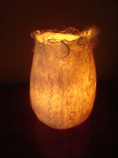 wet-felted vessel with light