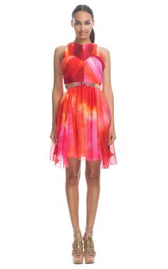 This watercolor printed sleeveless chiffon dress features ruching throughout, a slight racer front and an A-line silhouette  Hidden zip with hook-and-eye left side closure