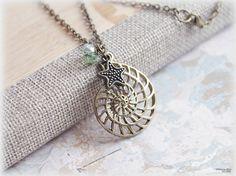 Nautilus shell and starfish charm necklace by MacKenziesAttic, $10.00