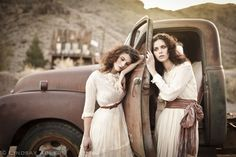 Ghost Town Fashion Editorial shoot for Framed Networking. Models in dresses leaning on vintage car. Lindsay Adler Photography.