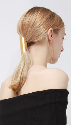 Barrette 044 in Gold. Large, rounded sculptural ponytail hair tie in gold. One size Sculptural, curved ponytail barrette hair tie. care instruction - Handle wi