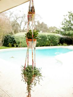 Make a Plant Hanger From Old T-shirts >> http://www.diynetwork.com/how-to/make-and-decorate/crafts/how-to-make-a-t-shirt-planter?soc=pinterest
