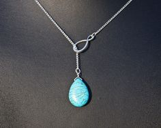 Etsy https://www.etsy.com/nl/listing/164761559/infinity-and-turquoise-lariat-necklace
