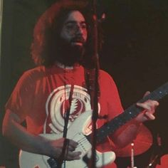 Jerry Garcia wearing a SYF shirt playing the T. Bean. Unusual shirt for him. Around '77.