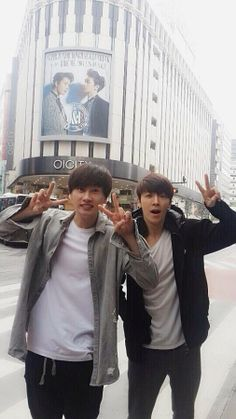 Super Junior's Donghae and Eunhyuk Pose in Front of Their Own Posters