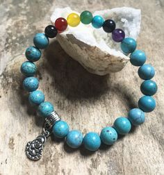 A personal favorite from my Etsy shop https://www.etsy.com/ca/listing/484710393/turquoise-and-chakra-stone-buddha