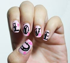 "Pink ""LOVE"" heart nails by Instgram: @M.F. Contreras Cantú"