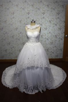 high quality luxury halter ball gown applique organza wedding gown with long train. $335.00, via Etsy.