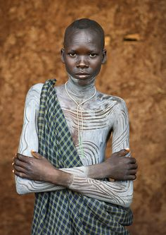 Suri Tribe boy with painted body, Kibish, Omo Valley, Ethiopia, oby Eric Lafforgue. Eric Lafforgue, African Tribes, African Women, We Are The World, People Around The World, Underwater Photography, Portrait Photography, Underwater Photos, Wedding Photography