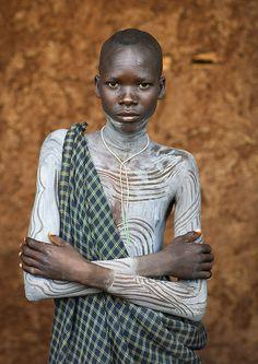 Suri Tribe Boy With A Painted Body, Kibish, Omo Valley, Ethiopia   © Eric Lafforgue