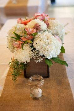 Rustic wood box flower centerpieces for a country chic wedding | www.meadowlakeroad.com