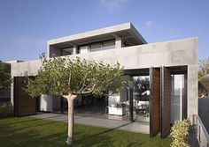 Surprising Small Modern House Design: Outstanding Small Contemporary House Design Ideas Large Clear Glass Sliding Door Concrete Wall Remarkable Simple House Design With Steel Frame Wood Folding Door Patio Porch Grass Lawn Backyard And Small Tree ~ idungu.com Architecture Inspiration