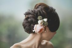 Voluminous textured wedding updo with fresh flowers
