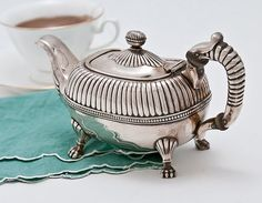 striking old footed teapot