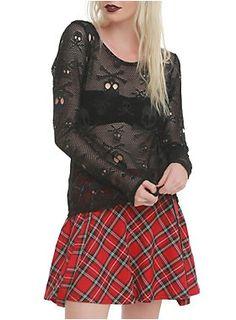 <p>Black long-sleeved mesh top with skull detailing.</p>  <ul> <li>94% polyester; 6% spandex</li> <li>Hand wash cold; dry flat</li> <li>Imported</li> <li>Listed in junior sizes</li> </ul>