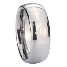 Superman wedding band for him. Omg, I don't think Superman would work, but Green Lantern, how perfect!  (I love that my guy is a nerd like me!)