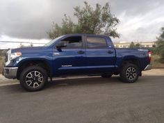 2014 TRD 4x4 with TRD Pro suspension added.
