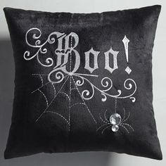 When it comes to Halloween, we're all about spooking up every nook and cranny in the house. That's where our miniature pillow comes in. It features elegant, scrolling embroidery to add a touch of spooky glam to your room.