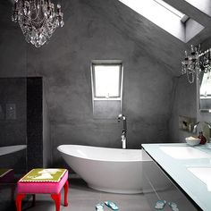 Concrete bathroom with colourful stool