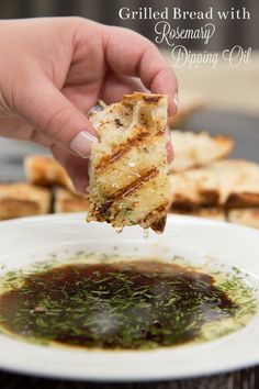 Garlic rubbed grilled bread with rosemary dipping oil. Perfect summer appetizer or side dish. Plus a recipe video!