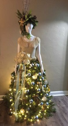 I started with a mannequin purchased at Restore for $45, a artificial tree (free)   and a roll of chicken wire. Her beautiful gol...