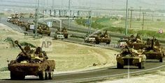 A column of French armoured vehicles drives on a Kuwaiti highway towards the northern desert where they will participate in joint military exercises with Kuwaiti forces on Monday, February 14, 2000. The maneuvers code named West Pearl 2000 includes French army personnel as well as Mirage 2000 fighter planes from the French airforce. The jets will take part in the exercises with Kuwaiti F18 fighter jets in joint flights in support of mock operations by ground, air and naval forces.