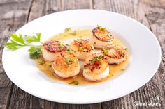 Delicate scallops in lemon sauce, a perfect fresh clean eating dinner.