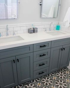 White subway tile, white counter, and gray/blue vanity with neutral walls