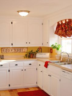 To make the most of her already sunny kitchen, HGTV fan stephiecamp used a trick that psychologists discovered ages ago: Red and yellow make people happy and hungry. To make her clever kitchen combination pop, she added white accents and cabinetry.