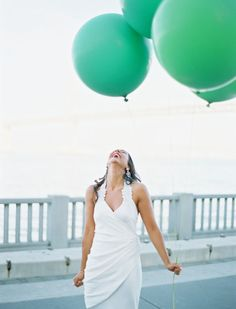 happiness is a huge bunch of green balloons on your wedding day!