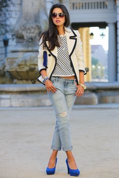 Statement blazer with cropped boyfriend jeans, bright heels.