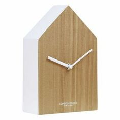 A confident departure from the norm, the Hus is a definite high point in the London Clock Company's UK designed Oslo Range. Its composite wood case and painted surround evoke the prosaic child's drawi. Tabletop Clocks, Mantel Clocks, Clock Decor, Desk Clock, Silver Wall Clock, Wall Clock Wooden, Wood Clocks, Oslo, Recycled Brick