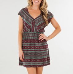 V-Neck Cinched Waist Dress  A bold graphic pattern and a flattering cut make this dress an effortless standout! Featuring a V-neck and cap sleeves, the cinched waistband and flared skirt create a flattering silhouette. Layer it with a cardigan during the day or pair it with tights and heels at night!