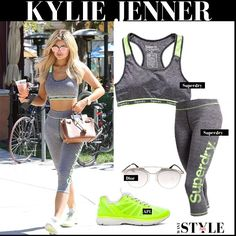 Kylie Jenner in grey sports bra, grey leggings and yellow sneakers