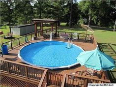 Here we see another deck all the way around a round above-ground pool. This deck is an amazing gathering spot for family pool times.