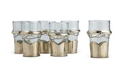They had these all over when I was in Morocco! Moroccan tea glasses adorned with silver.