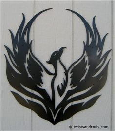 phoenix bird metal art | This design is displayed at a home in Glendale Arizona