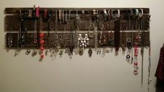 Jewelry Organizer for Necklaces, Bracelets, Rings and Earings. Made with old deck steps.  Use furniture tacs for neckalces, finish nails for rings, wood dowel held up with 2 coffee cup type hooks for bracelets and a piece of yarn tacked up to bottom board for earrings.  Total OOP $9.07.