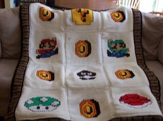 Crocheting: Mario Blanket.  Cute, but would be cooler if the design had been worked in rather than cross stitched (graphed tunisian crochet).  There's another Mario Bros afghan out there that's totally epic!