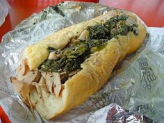 PENNSYLVANIA: ROAST PORK SANDWICH -- Everyone knows about Philly cheesesteaks, but a handful of city sandwich shops up the ante with a similar-looking but more deluxe roast pork sandwich: moist, sweet meat forked from a drippy trough and piled into a seeded roll, supplemented by clumps of spinach or broccoli rabe sautéed in olive oil with plenty of garlic. Forget cheese; here, it is only a distraction.